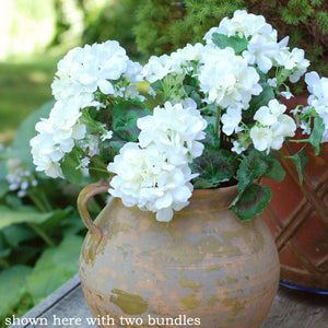 Our White Geranium Bundle will fill your farmhouse with French Country style. Featuring huge clusters of creamy white, semi-double flowers, the arrangement comprises six fully blossomed faux geraniums along with sprays of greenery.