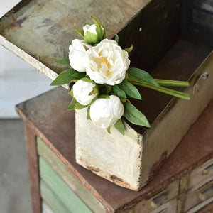 Fill your farmhouse with spring's beauty year-round with our White Peony Bouquet. The lushly layered petals form exquisite rosettes along with rich green leaves. The flowers and stems stand 11 inches tall and are made of a silky fabric, which gives our Peony Bouquet its lifelike beauty.  One bunch contains five peonies in various stages of opening--from bud to full bloom.