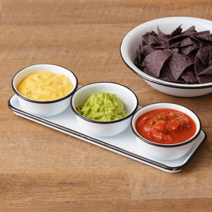 "Our White Enamel Condiment Tray with Bowls is perfect for casual farmhouse style entertaining. This enamelware caddy features a classic white enamel tray with black trim and three matching bowls. The tray can be used to hold crackers, while the bowls serve up condiments, dips, salsa, olives or nuts. Tray: 5""W x 13.5""L, Bowls: 4.75"" Diam x 2""H"