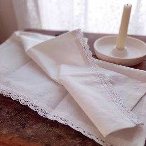"The White Lace and Cotton Napkins are inspired by 19th century French linens. Made with 100% cotton, two ends are decorated with sweet lace. These napkins evoke a vintage charm and bring timeless French Country elegance to your farm table. Machine wash. Set of 4. 18"" x 18"""