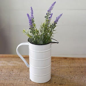This vintage style enamelware pitcher has a nostalgic feel, inspired by flea market finds of old tin measuring cups. Our White Enamel Measuring Pitcher features an aged finish. A great addition to any farmhouse kitchen.