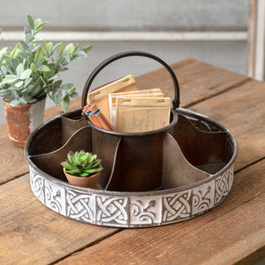 The perfect blend of rustic and elegant, our White Wash Metal Storage Caddy features a vintage design inspired by old tin ceiling tiles. The handle on this item folds down and it has six evenly divided bins. Ideal for a craft studio, home office, or farmhouse kitchen.