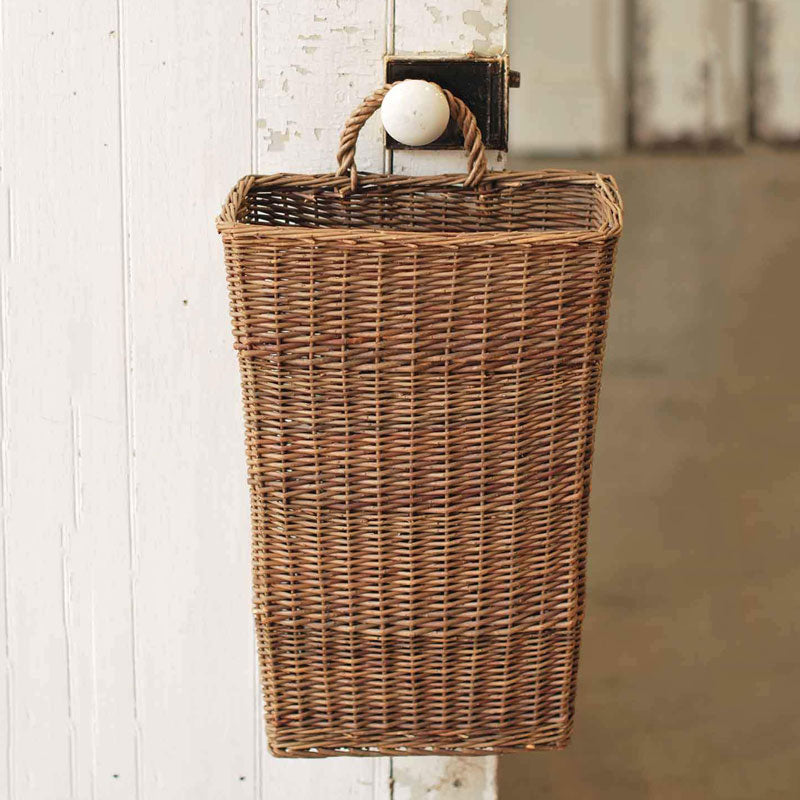 Willow Door Basket, Nothing says country cottage style quite like this hanging Willow Door Basket. Perfect for any season. Fill it with your favorite flowers or greenery, and welcome guests with this eye-catching basket. It also comes in handy when gathering long-stem flowers from the garden.