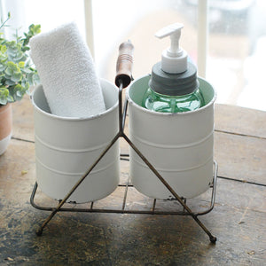 Give utensils a vintage style home or dress up your bathroom counter with this Wire Caddy with Tin Pots. The weathered antique white pots bring a sweet shabby chic style. This versatile holder will come in handy in any farmhouse kitchen or bath.