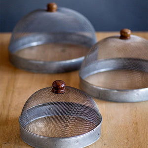 A screen cloche, also known as a shoo-fly, is perfect for protecting food from flies and other insects.  Our set of three Wire Mesh Food Covers has tons of vintage charm and offers a range of sizes. The small one is perfect for keeping butter and other small items covered.
