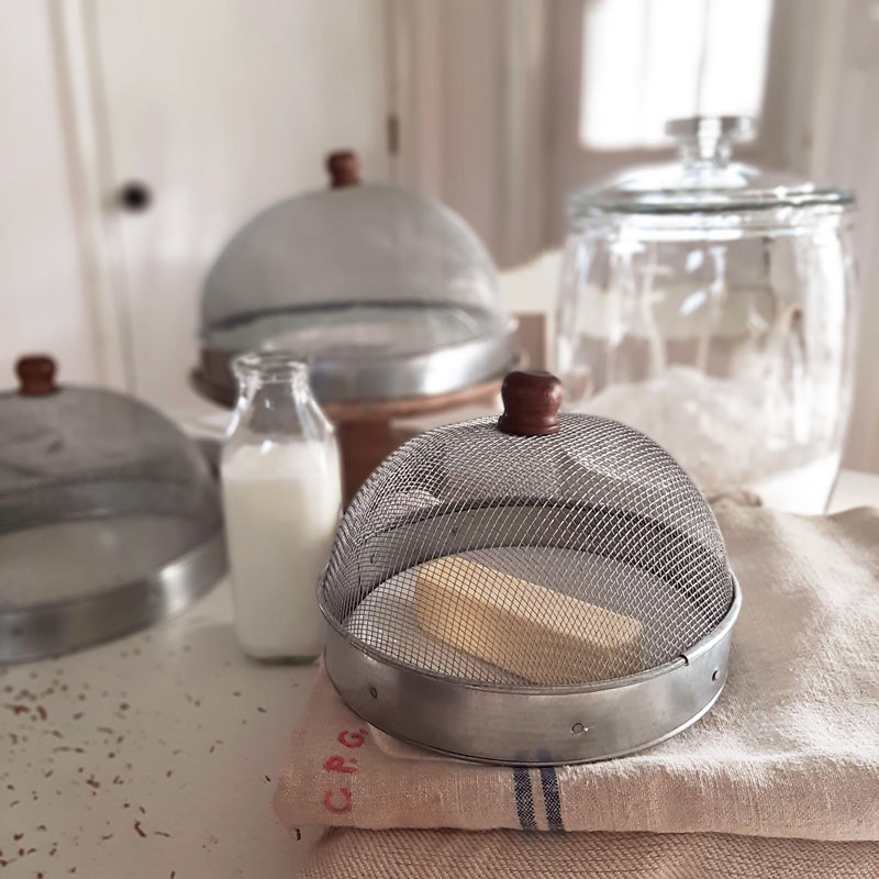 A screen cloche, also known as a shoo-fly, is perfect for protecting food from flies and other insects.  Our set of three Wire Mesh Food Covers has tons of vintage charm and offers a range of sizes. The small one is perfect for keeping butter and other small items covered.  The nest together easily for storage. Add rustic elegance to your farmhouse kitchen or patio with our vintage style Wire Mesh Food Covers, Set of Three