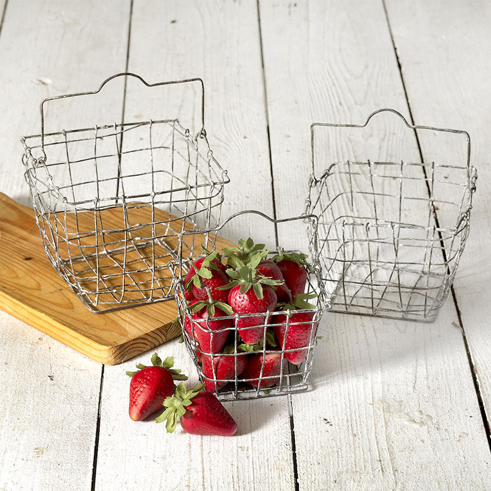 Our Wire Berry Baskets have quintessential vintage farmhouse style. The set of three square wire baskets with handles is perfect for kitchen or bath! This antique inspired wire mesh baskets features a weathered whitewash finish.