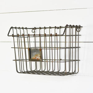 "The Wire Wall Basket is ready to tackle small space storage challenges. The vintage style wire basket with label holder reminds us of antique gym bins. Hang by the bedside to keep your nighttime reading essentials from cluttering your nightstand. Store magazines or mail or keep one in the mudroom for gloves and hats. You'll find tons of uses for this Wire Wall Basket.  11.25""L x 6.5""W x 7.75""H"