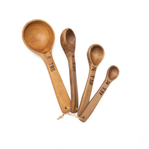 "Bring rustic farmhouse style to your cooking with this Wood Measuring Spoon Set. These handmade wooden measuring spoons are so nice you won't want to use them and get them dirty! This set will complement any kitchen. Made of laurelwood, each is unique, no two are exactly alike! Handmade and fair trade. Includes: 1 tbs, 1 tsp, 1/2 tsp, 1/8 tsp. Full set is 5""L x 1.5""W"
