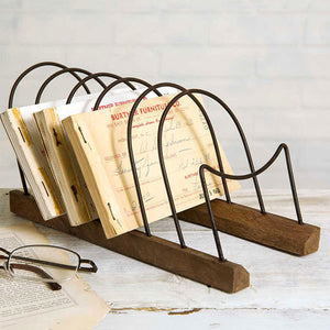"Our Wood and Wire Plate and Letter Rack is a versatile piece. Display small dessert plates on a buffet for rustic style farmhouse entertaining or organize letters, cards and other papers. Features a wood base and metal loops. 4.5""W x 9.5""D x 4.5""H (Recommended for small plates only. Shown here with 7.5"" Diam plates, not included.)"