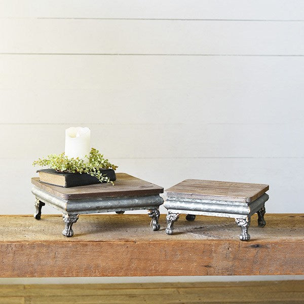 Our Wood and Metal Tabletop Risers are a great way to take your entertaining style to a new level. Elevate your food and cheeses for a touch of elegance. They're also great on countertops to hold everyday condiments, plants, and decorative knick-knacks. Features decorative metal feet and a rustic wood top