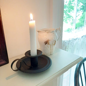 Inspired by 18th-century colonial style candle holders, our Wyeth Chamberstick Taper Holder features an aged metal finish with flecks of brown for a time-worn feel. It has the classic finger loop and tray, which made it easy to carry candles from room to room. Taper candle not included. This piece makes a simple yet elegant accent to any room in your farmhouse.