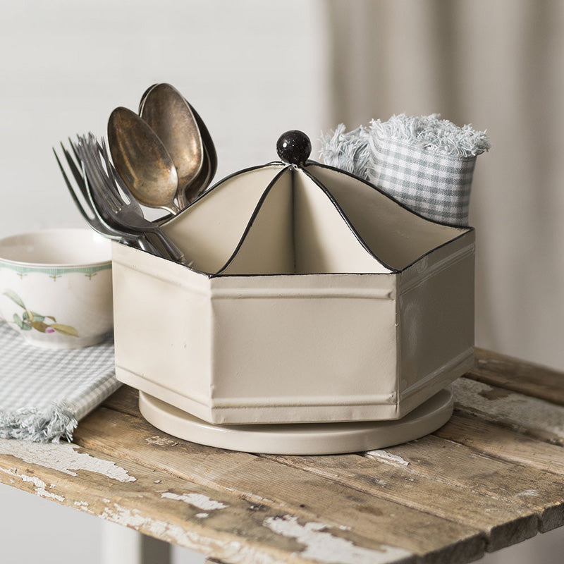 From utensils and napkins to condiments or crafts, our Carousel Caddy is perfect for keeping things organized. Inspired by vintage style office bins, this light beige metal tray rotates, Lazy-Susan style.