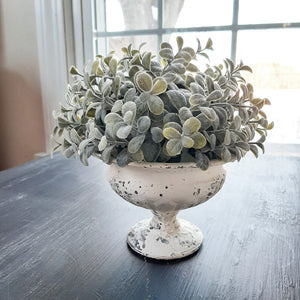 This Chippy Cream Urn with Eucalyptus Sphere makes a charming combination. What we like about this accent is that you can use each item individually with ease. The Eucalyptus Sphere, has a soft grey green hue, and it removes easily, so you can add it to any urn or compote of your choice. The chippy paint cream urn is great for candles, Easter eggs or any little decorative pieces you cherish.