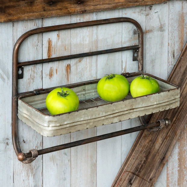 Add vintage style to your kitchen or bathroom with this Farmhouse Metal Shelf and Towel Rack. Its aged patina makes this reproduction feel like an antique shop find. Features wire mesh at bottom of the shelf for added farmhouse charm.