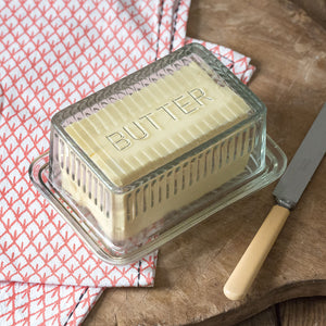 "Keep butter close at hand with our Vintage Style Glass Butter Dish. Reminiscent of those found in old country kitchens, its vintage design brings fond memories of grandma's kitchen. 6.5""L x 4.75""H x 3""W"