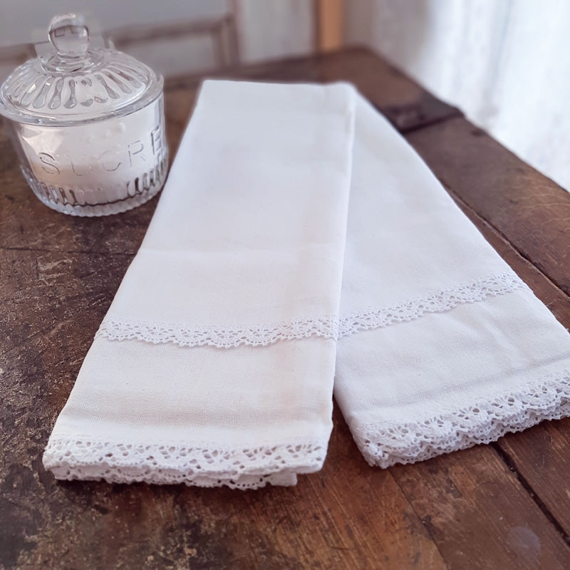 "The Dishtowels White Lace and Cotton are inspired by 19th century French linens. Made with 100% cotton, they feature a white lace detail. These dishtowels evoke a vintage charm and bring timeless French Country elegance to your farm table. Machine wash. Set of 2. 20""L x 28""H"