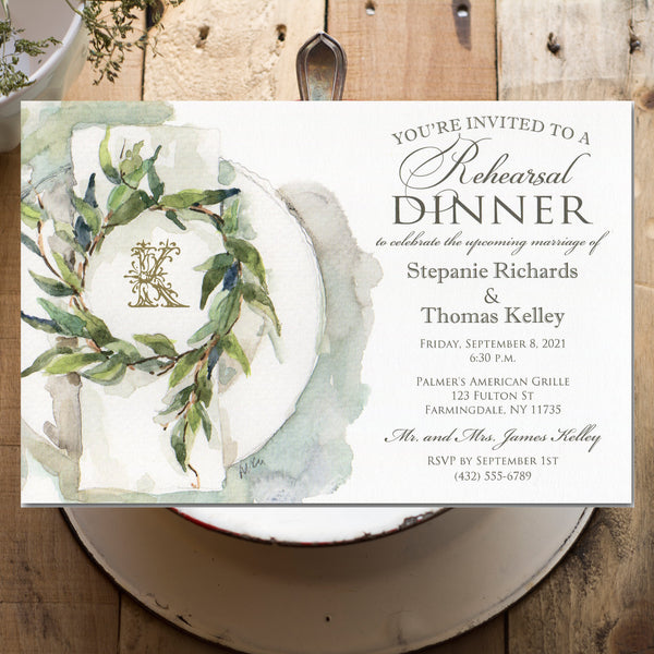 wedding rehearsal dinner invitations with linen napkin and leaf wreath
