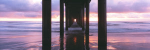 Sunrise over the Pacific Ocean seen from under Scripps Pier, La Jolla Shores Beach, La Jolla, San Diego County, California, USA