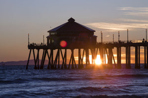 Pier in the Pacific Ocean at dusk, Huntington Beach Pier, Huntington Beach, California, USA