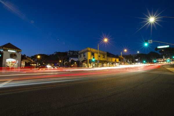 Light streaks on street at night, Laguna Beach, California, USA