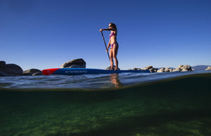 Woman paddleboarding in the lake, Lake Tahoe, Nevada, USA