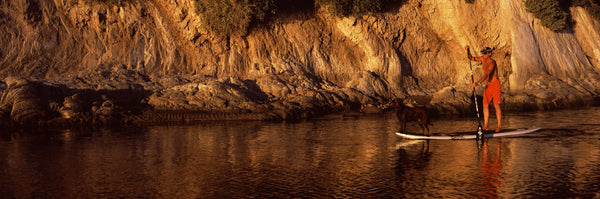 Paddle-boarder in river, Santa Barbara, California, USA