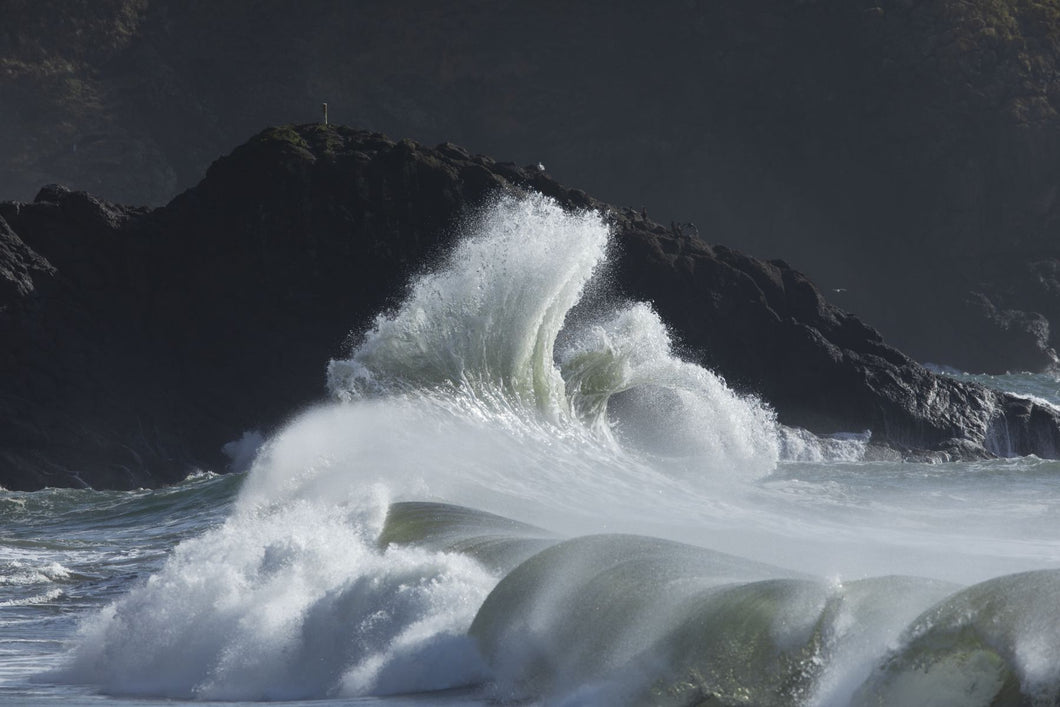 Waves crashing on rock formation in sea, Cape Disappointment State Park, Washington, USA