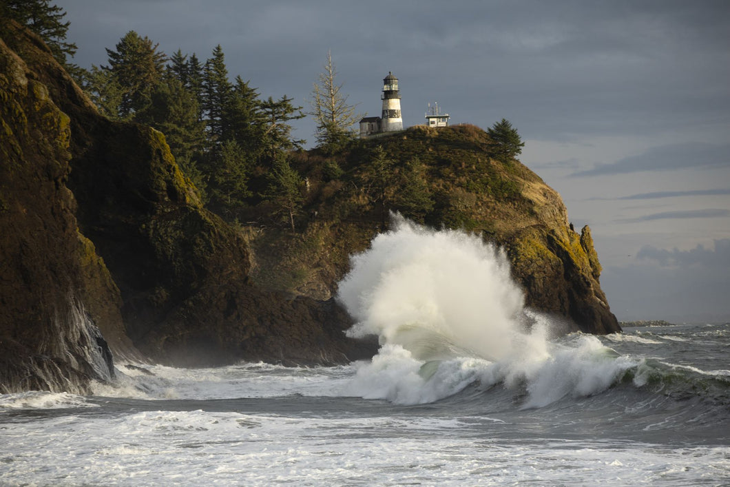 Crashing waves and lighthouse, Cape Disappointment State Park, Washington, USA