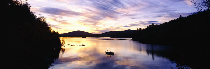 Sunset over a lake, Saranac Lake, Adirondack Mountains, New York State, USA