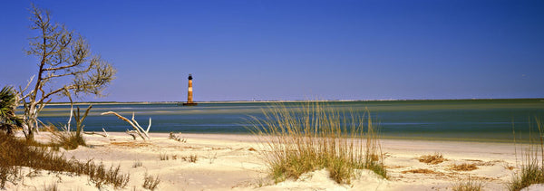 Beach with lighthouse in the background, Morris Island Lighthouse, Morris Island, South Carolina, USA