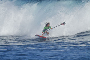 Standup paddleboarder surfs a breaking wave in the ocean, Maui, Hawaii, USA