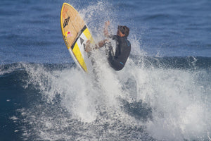 Kai Lenny a famous paddle surfer paddleboarding in the ocean, Ho'Okipa, Maui, Hawaii, USA