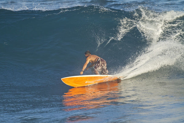 Dave Kalama a famous surfer surfing in the ocean, Maui, Hawaii, USA