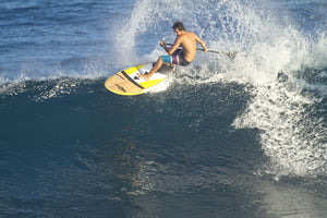 Kody Kerbox a famous paddle surfer paddleboarding in the ocean, Ho'Okipa, Maui, Hawaii, USA
