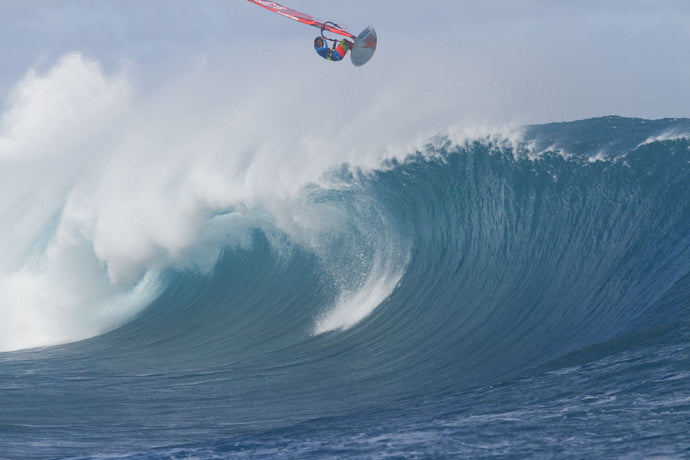Person windsurfing in the ocean, Teahupo'o, Tahiti, French Polynesia