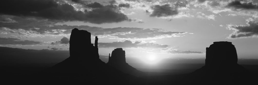 Silhouette of buttes at sunset, Monument Valley, Utah, USA