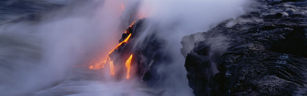 High angle view of lava flowing into the Pacific Ocean, Volcano National Park, Hawaii, USA