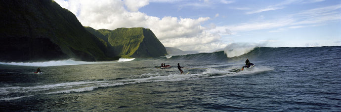 Surfers in the sea, Hawaii, USA