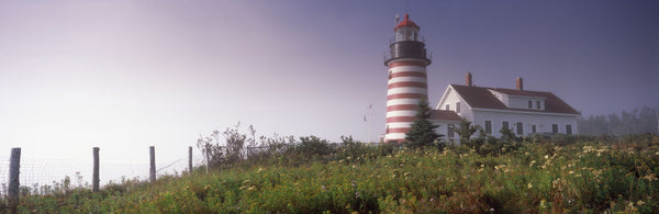 Low angle view of a lighthouse, West Quoddy Head lighthouse, Lubec, Washington County, Maine, USA