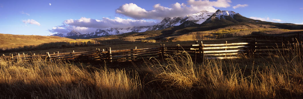 Fence with mountains in the background, Colorado, USA