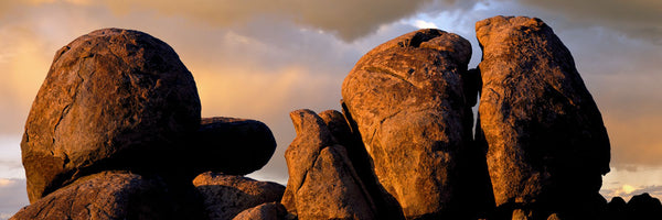 Monolithic boulders glow at sunset, Joshua Tree National Park, California, USA