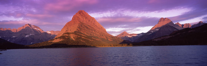 Lake with mountains at dusk, Swiftcurrent Lake, Many Glacier, US Glacier National Park, Montana, USA