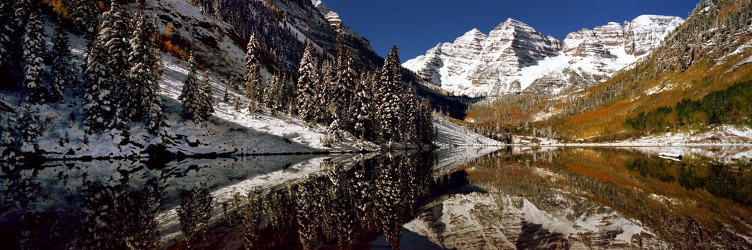 Reflection of snowy mountains in the lake, Maroon Bells, Elk Mountains, Colorado, USA