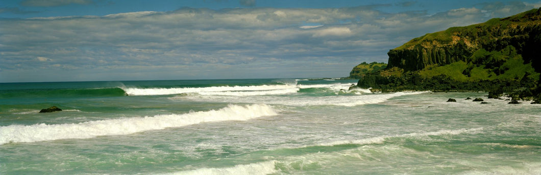 Waves breaking on the shore, backside of Lennox Head, New South Wales, Australia