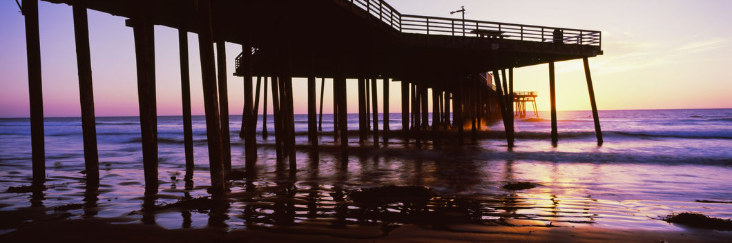 Silhouette of a pier at dusk, Pismo Pier, Pismo Beach, San Luis Obispo County, California, USA