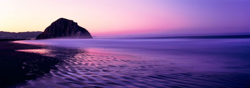 View of beach at sunrise, Morro Rock, Morro Bay, San Luis Obispo County, California, USA