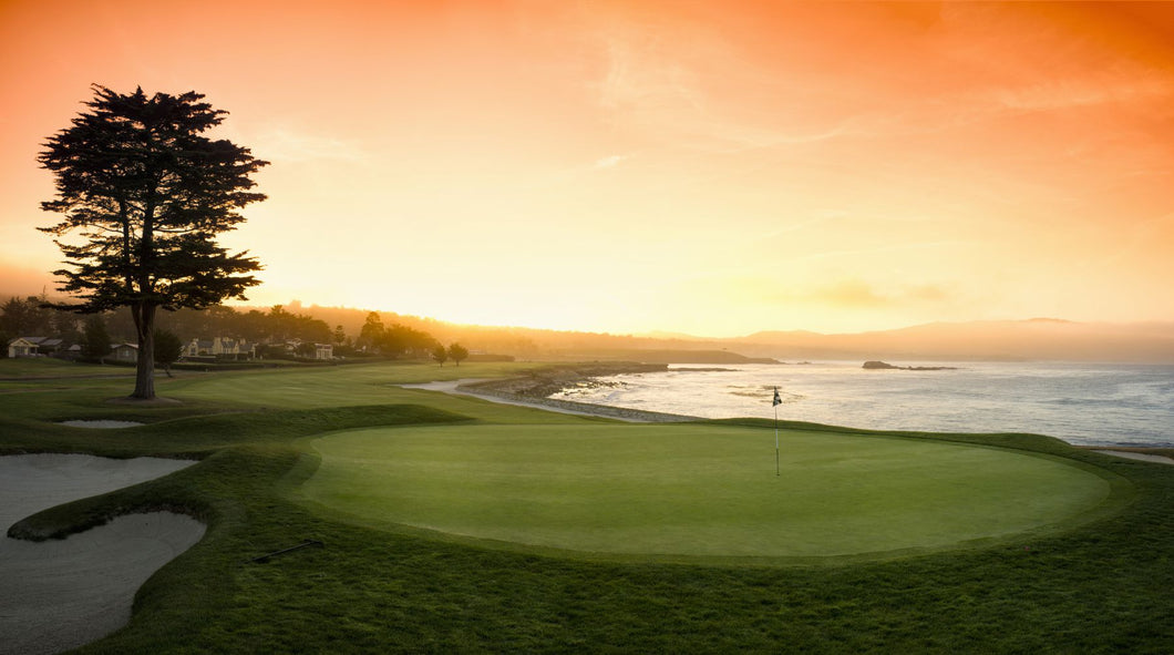 18th Hole with iconic cypress tree at sunrise on Pebble Beach Golf Links, Pebble Beach, California, USA