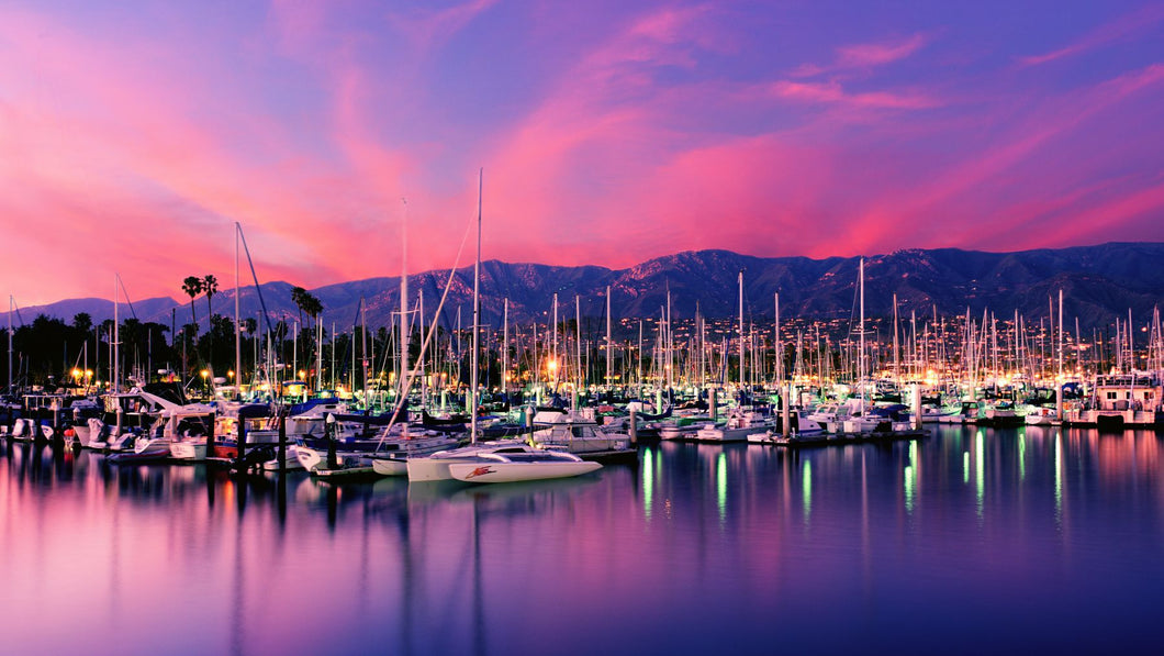 Boats moored in harbor at sunset, Santa Barbara Harbor, Santa Barbara County, California, USA