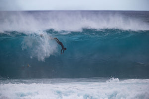 Surfer falling off into breaking wave, Hawaii, USA